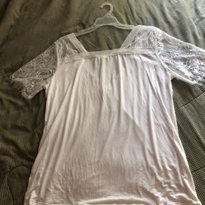 White knit shirt trimmed with lace